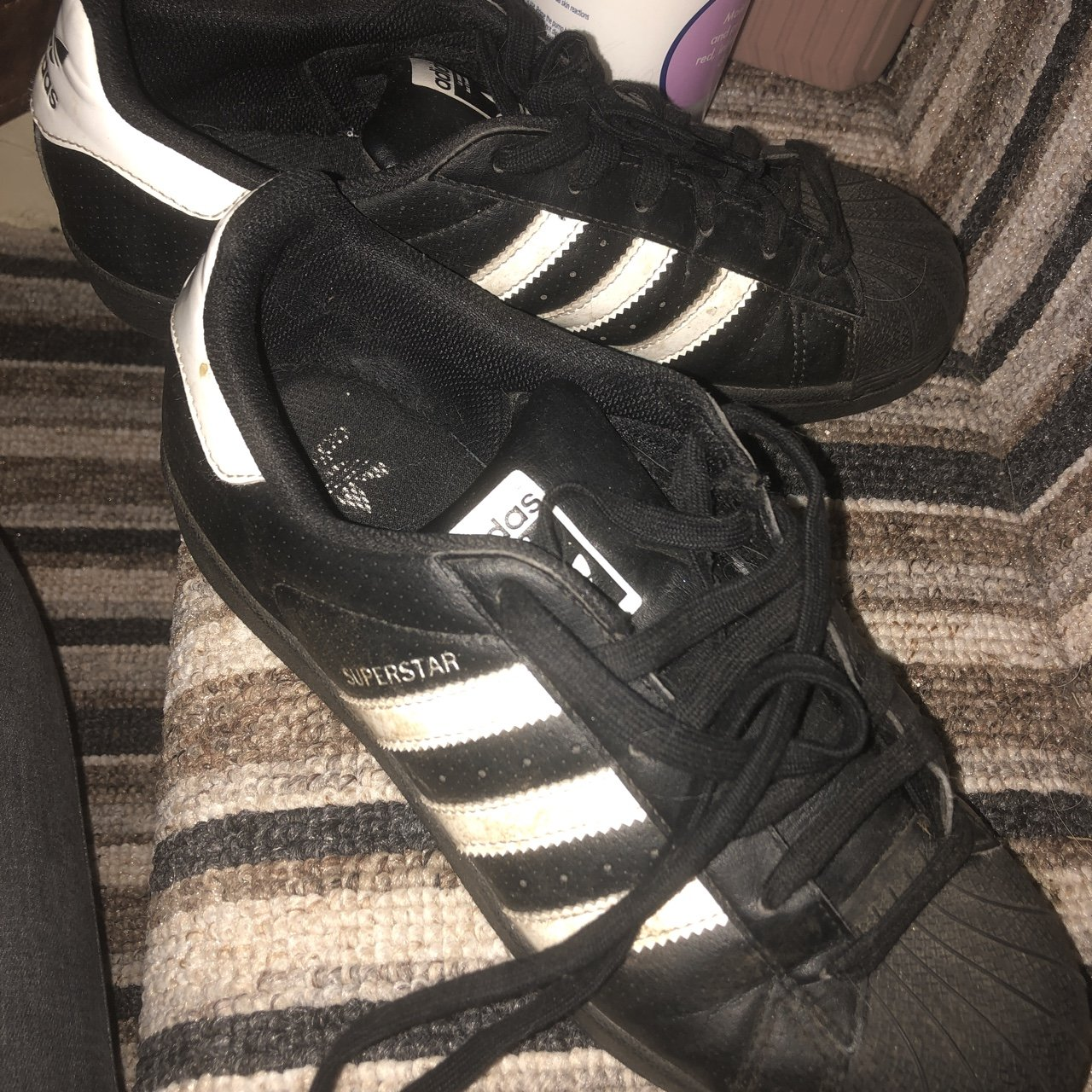 Black and white Adidas superstars b628959a4a07