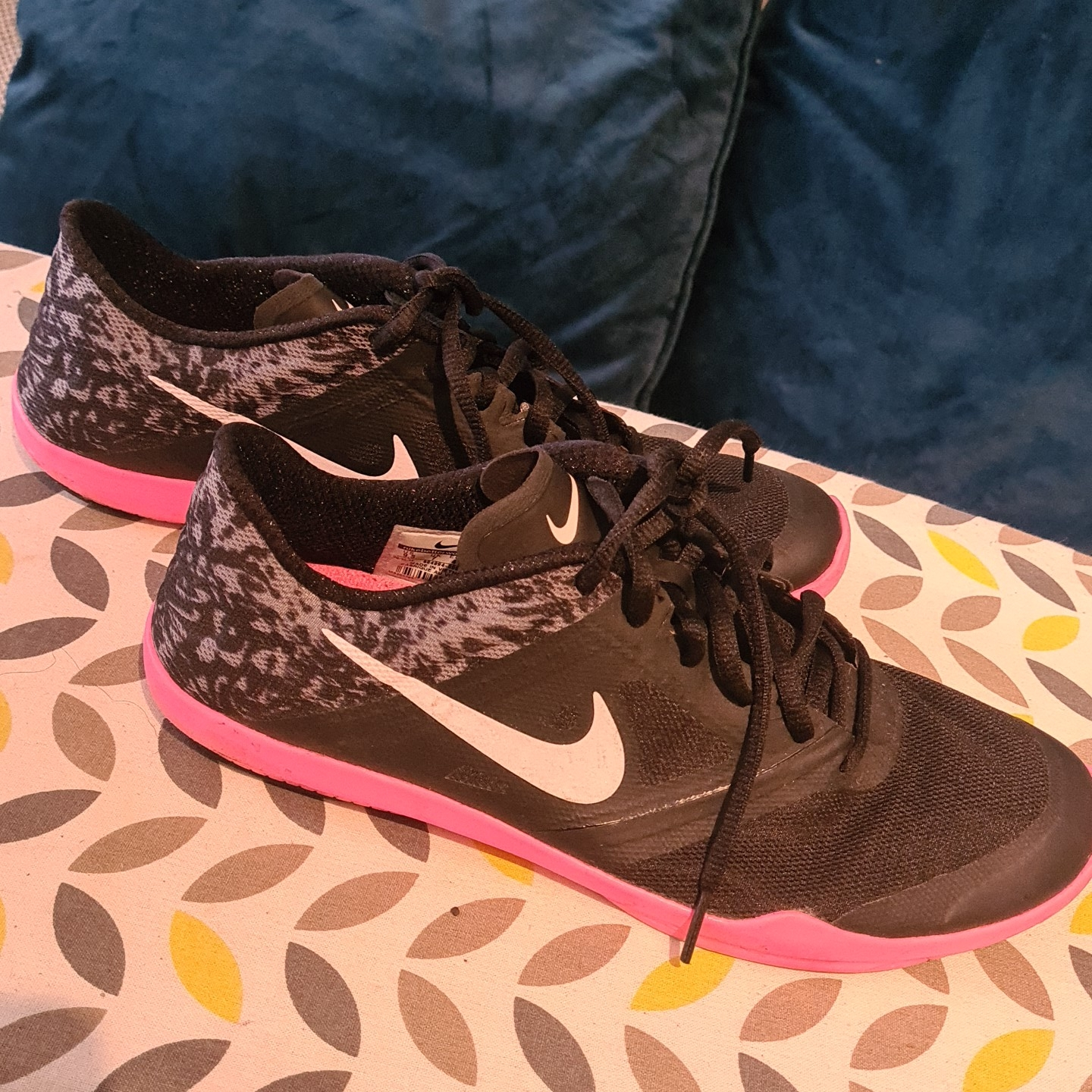 Pink and Black Nike trainers. Size 7