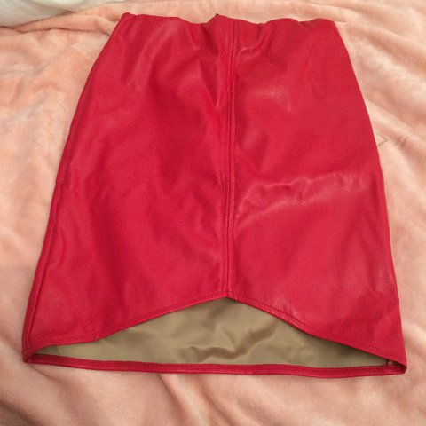 7d0403e6c @nd1243. 2 years ago. Glasgow, UK. Pretty little thing red faux leather  skirt in red! Asymmetric panel style. Brand new with tags ...