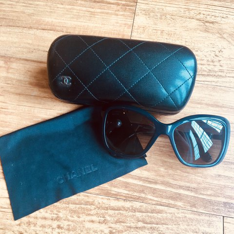 bcf0d548e0835 Navy Chanel sunglasses with pearl detail on the arms. Only I - Depop