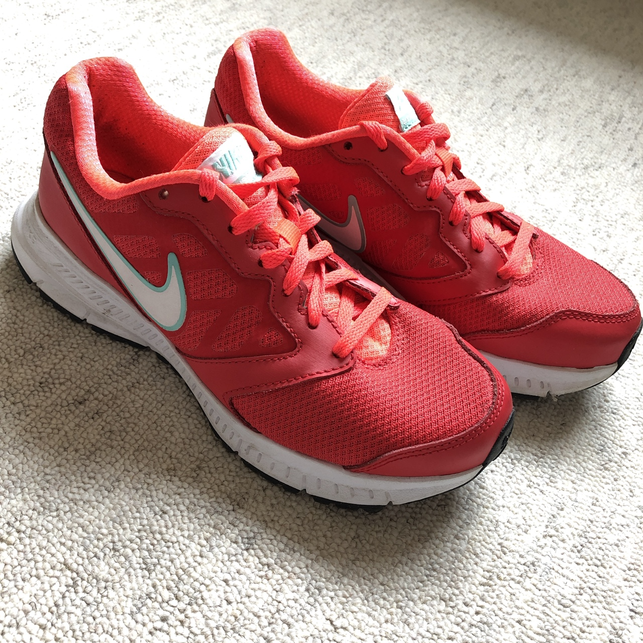 NIKE running trainers in red size 4