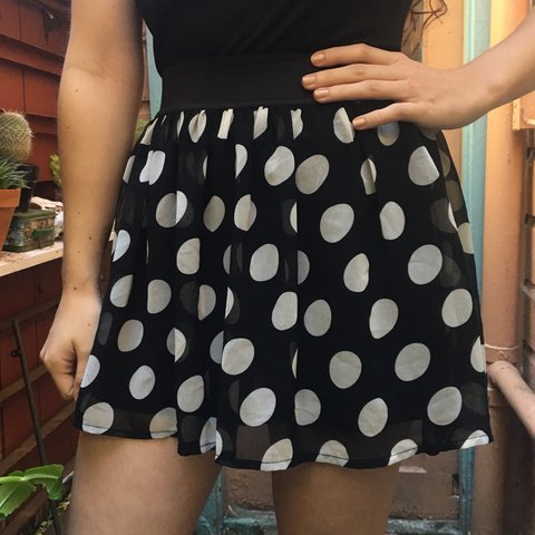 444f851394 @daphnelf. 4 months ago. San Francisco, United States. Black and white  polka dot print flowy mini skirt with elastic waistband 🖤 In perfect  condition