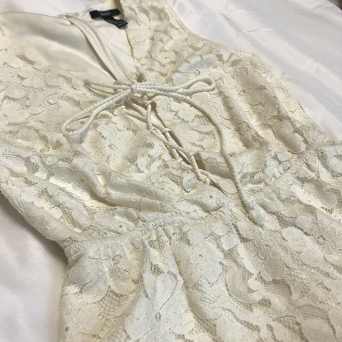0485bb27e1d Forever 21 tie up lace romper with zipper back. Non extra of - Depop