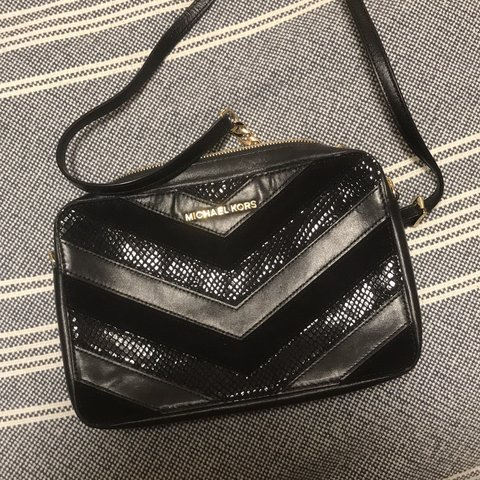 7e6fd0182717 @tangtangee. 4 months ago. Chicago, United States. Michael Kors Jet Set  black leather quilted front cross body bag