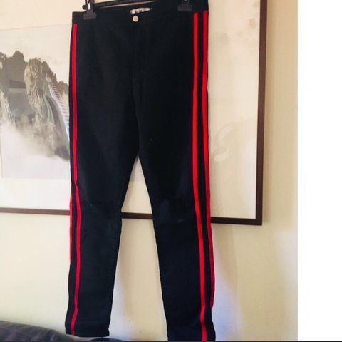6debf52545863 Black jeggings with knee cut outs and red stripes. fit and - Depop