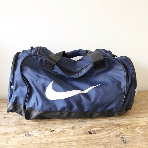 a99132365 90s Nike duffel bag Navy with white graphics Black zippers a - Depop