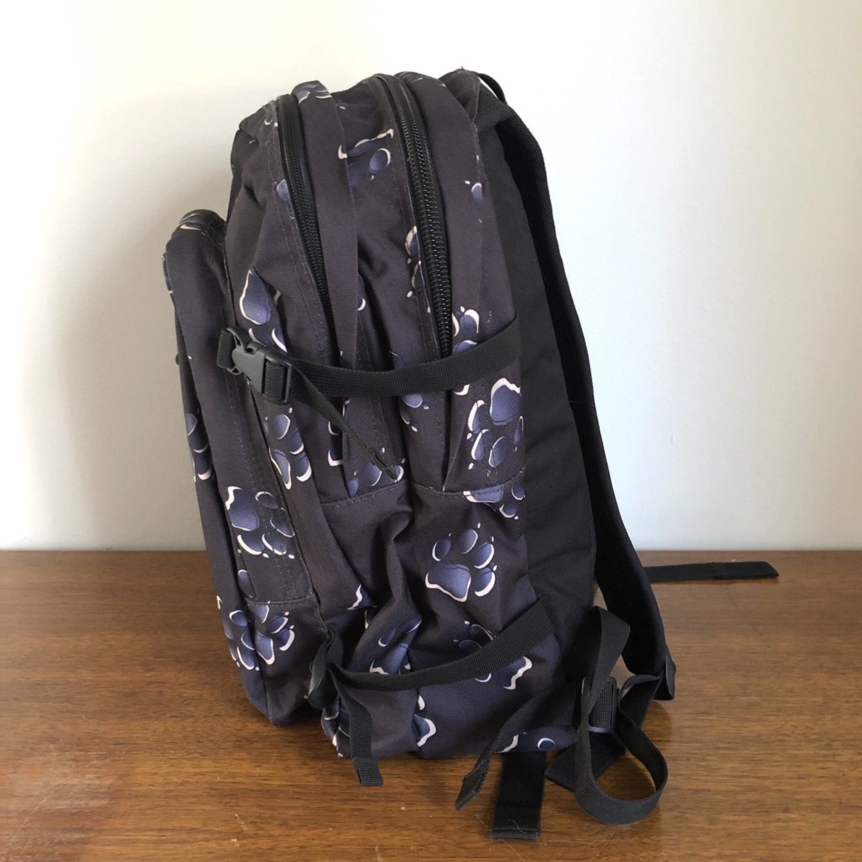 90s Jack Wolfskin backpack Black with navy blue paw Depop