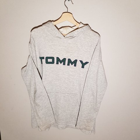 f5abddbd494f Grey Tommy Hilfiger hoodie with a green spellout and a on - Depop