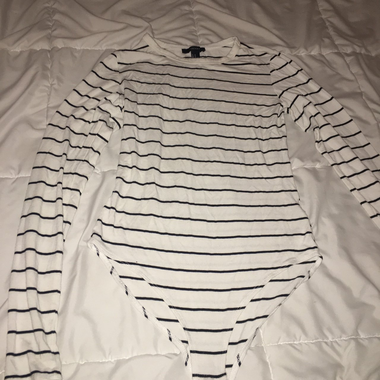 bd879e9d8b  aleyamaria. 8 months ago. United States. forever 21 white with Black stripes  long sleeve bodysuit!!