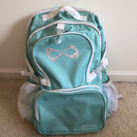 00034de43bb5 Item is on hold me teal nfinity book bag for cheer lovers - Depop
