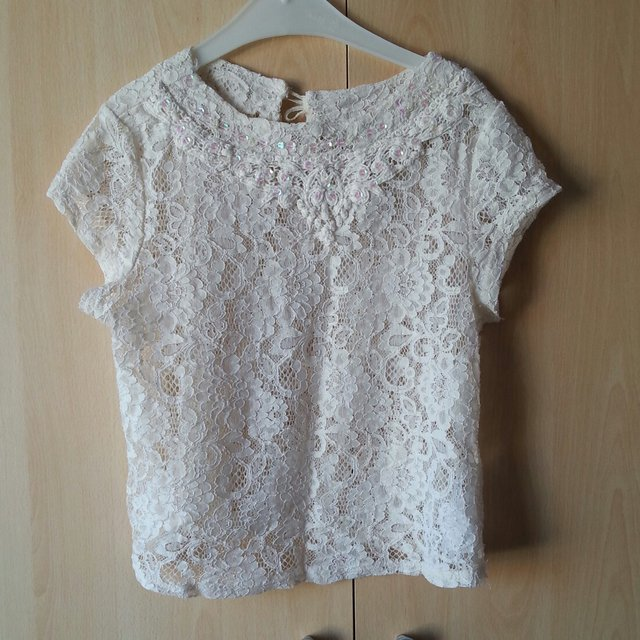 0aca4d56b68018 New Look ivory lace crop top with pink sequin detail around - Depop