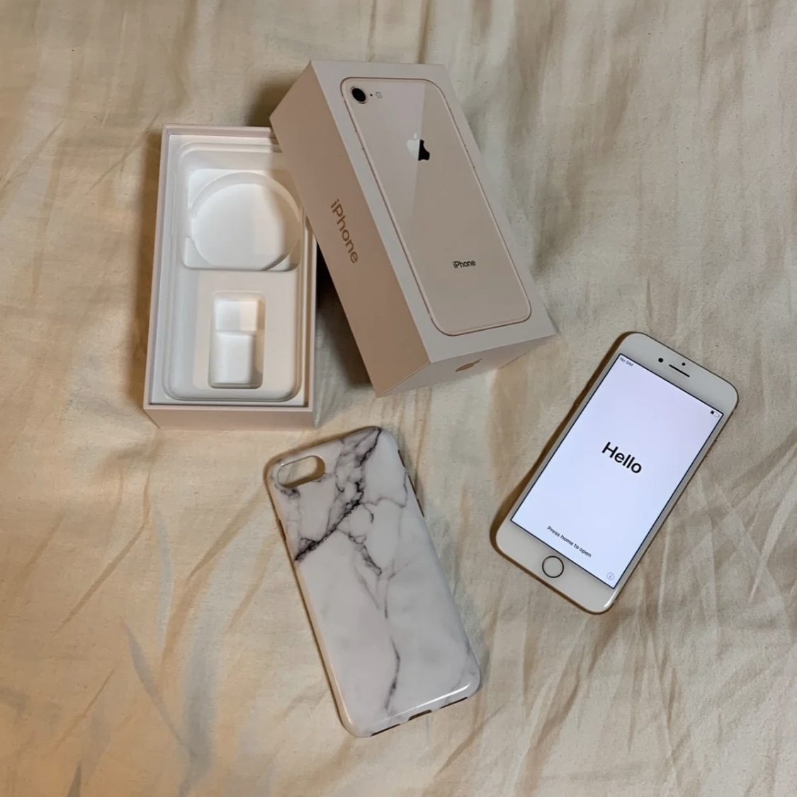 Gold iPhone 8 256GB unlocked, factory reset, and SIM