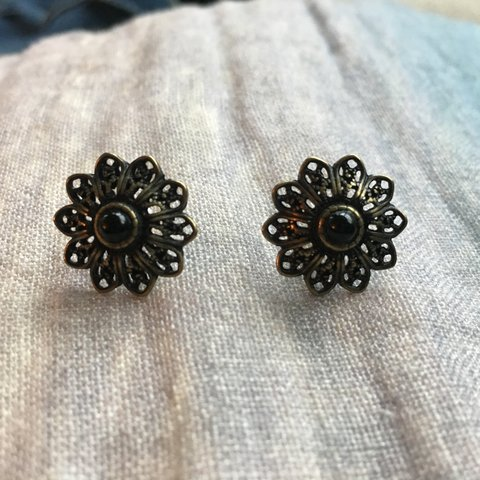 3da97fe6e @acb345. 6 months ago. New York, United States. Bronze post earrings from  Anthropologie. Delicate stud ...
