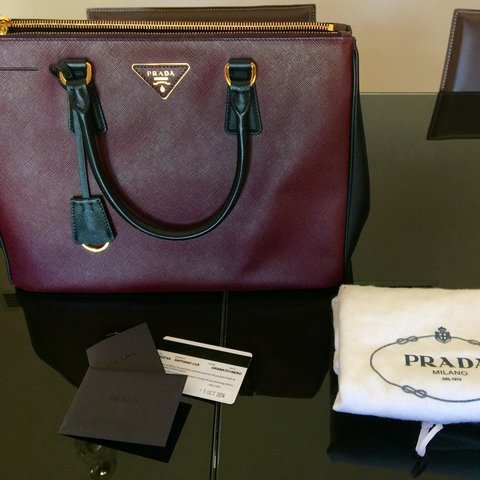 5ac16a67624b @giselejenine. 3 years ago. Cyprus. Prada Two Tone Burgundy and Black  Saffiano Luxe Tote Medium limited edition ...