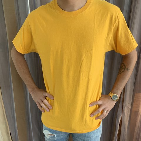 ddbd9963 @ogskii. 4 months ago. Orleans, United States. Authentic yellow champion t  shirt