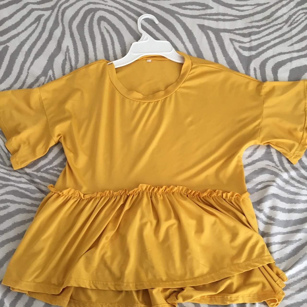 96836051ee Cute yellow flowy shirt from shein. couple stains but hardly - Depop