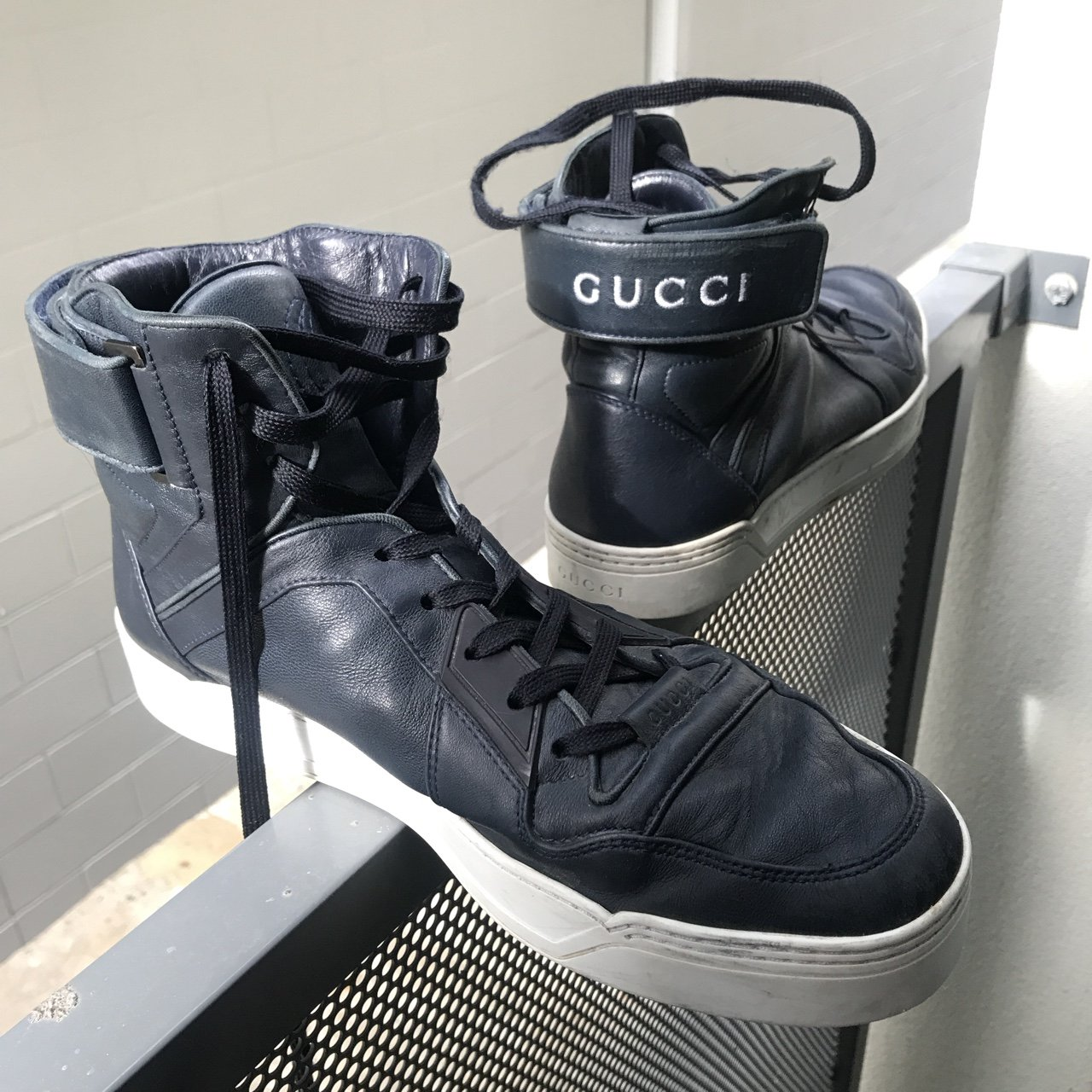 64dbad384c4 Gucci Guccissima hi-top leather basketball sneakers