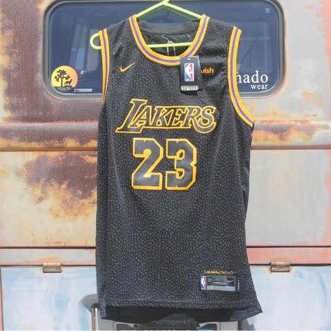 ea094253703 @photogeek__. 9 months ago. Torrance, United States. NBA new style Lakers  Jersey. Black on yellow.