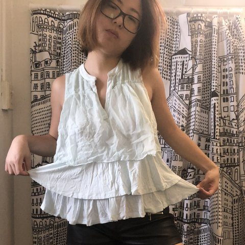 11f4036904179 Ruffle layers light blue top from Anthropologie. It has a on - Depop
