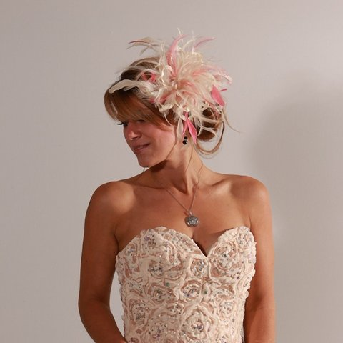 8de51aa5 @maighreadstuartmillinery. 11 months ago. Bolton, Greater Manchester,  United Kingdom. Small cream and coral satin loop feather fascinator hat.