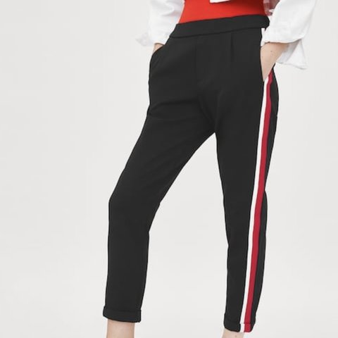 0c06c9c8 @revivalshop. 11 months ago. Los Angeles, United States. Zara Cuffed pants  with red/white side stripes || worn ONCE