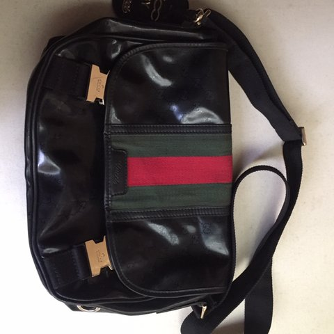 1e388631ced  rileyke. 3 months ago. United States. Pre owned gucci messenger bag.