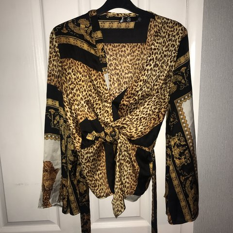 b5c4b2317f2b @12clothingshop08. 6 months ago. Penrith, United Kingdom. Leopard print  satin top from missguided.