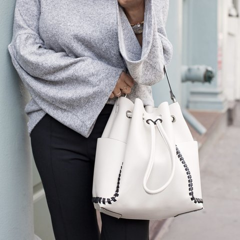 46e03ee3537 @megmills8. 10 months ago. Barnsley, United Kingdom. Sold out cute Zara off white  bucket bag with contrasting black ...