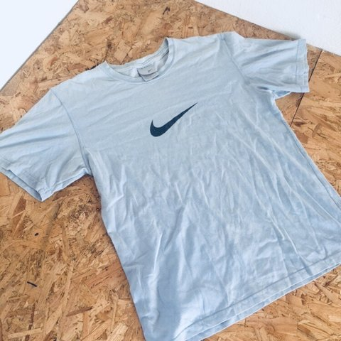 8ef942c30 @12piecebucket. 9 months ago. London, United Kingdom. Baby blue Nike t shirt