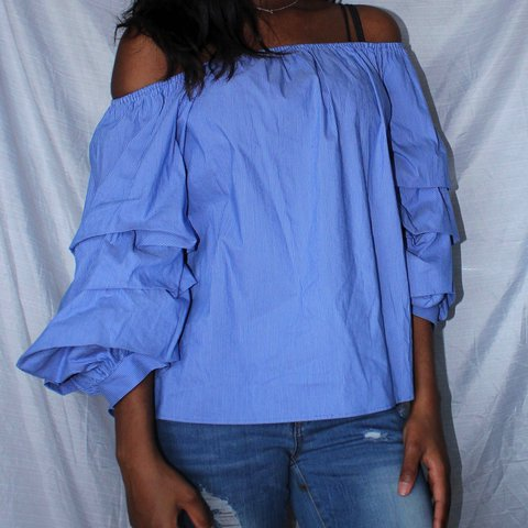 ff09892ec68 @oliveand. 11 months ago. Boston, United States. Zara blue striped off  shoulder shirt with puffy exaggerated ruffle sleeves.