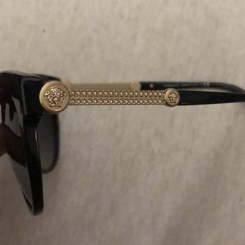 ef0e6386c0 brand new black Versace sunglasses with gold detailing and - Depop