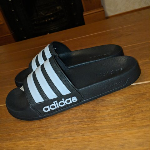 249ee000a MESSAGE ME FOR OFFERS 💲 Black and white Adidas sliders. New - Depop