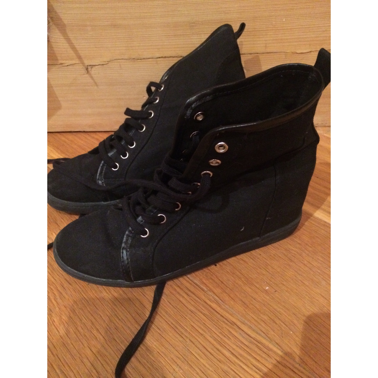 black trainers with heels