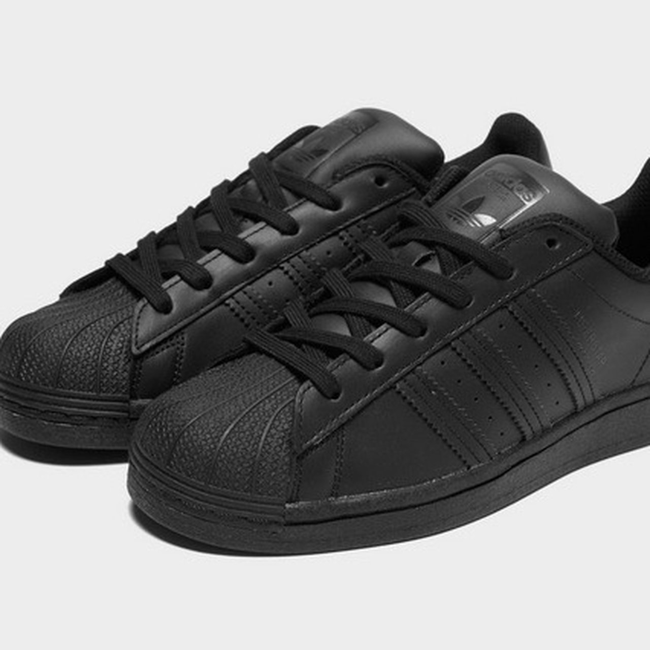 Adidas all black superstars in a uk