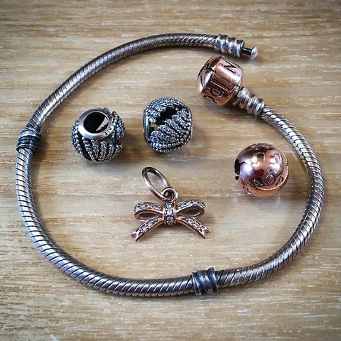 83e66780f @stephpearsonx. 9 months ago. York, United Kingdom. Rose gold pandora  bracelet with 3 charms and 1 clip.