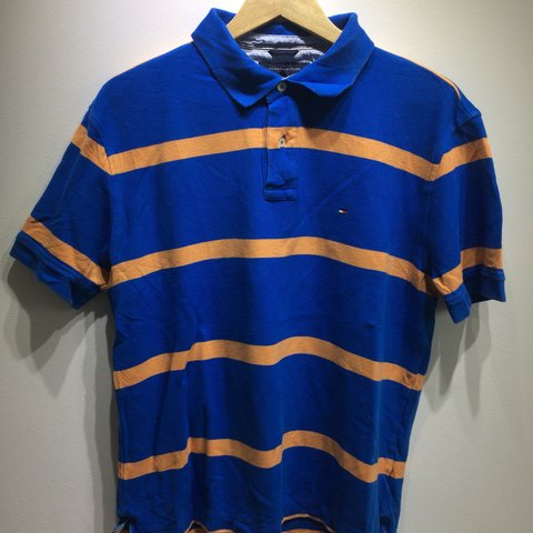 cc49b552 @fromtheloft. 15 days ago. Dunstable, United Kingdom. Tommy Hilfiger Men's  Size L Blue/Orange Striped Polo