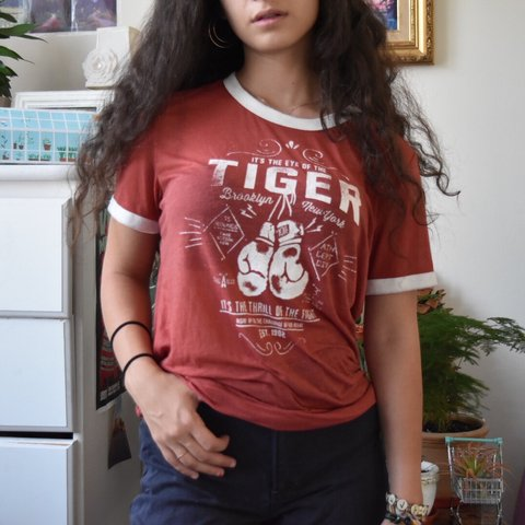 d6a8664e0 Super cute eye of the tiger ringer tee. Literally the most a - Depop