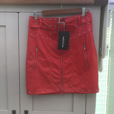 445bde71c @laura_jane2707. 3 months ago. Leeds, United Kingdom. Pretty little thing  studded leather skirt in red size 10, brand new with tags.