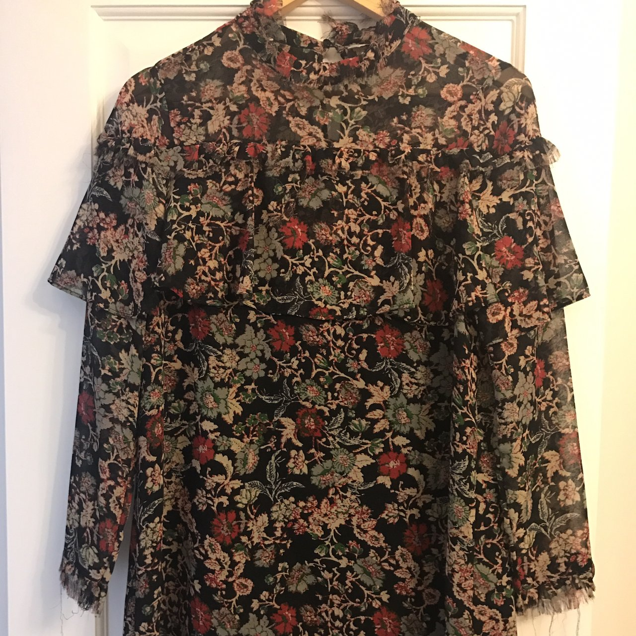 7062c626cb @naseemaj. 8 months ago. Bolton, United Kingdom. Zara high neck floral dress  with a ruffle and long sleeves.