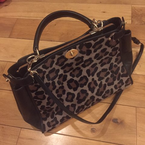 b76139590 Coach leopard print handbag with contrast leather side & on - Depop
