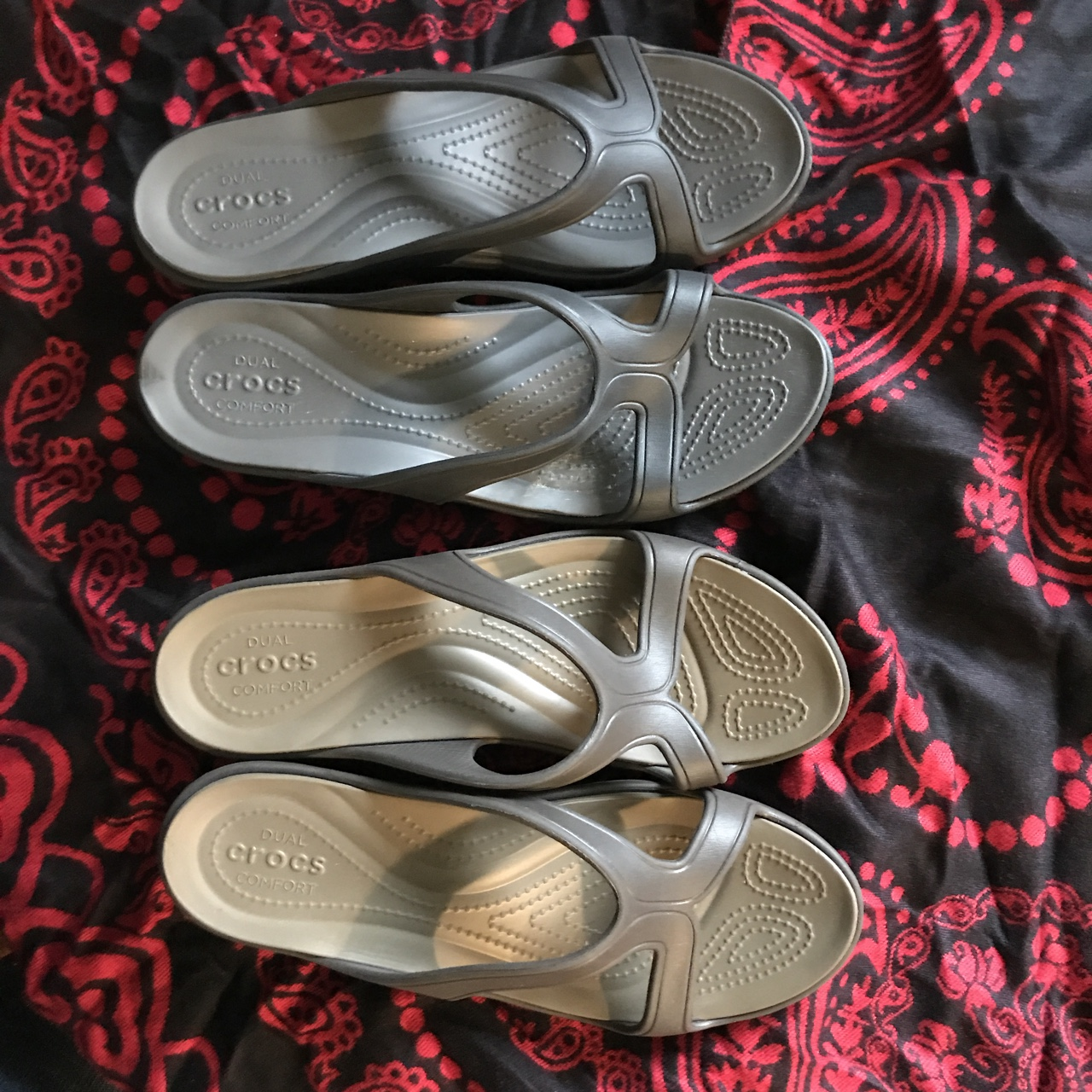 A pair of dual comfort crocs for sale