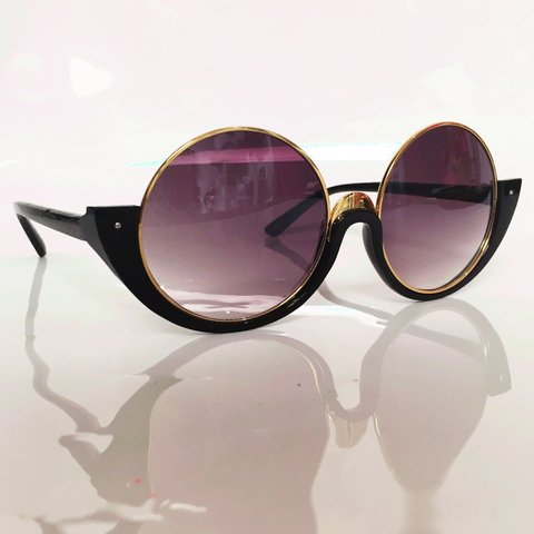 347c68e19547 @philipnormal. 4 years ago. London, UK. Vintage style round sunglasses in  black and gold.