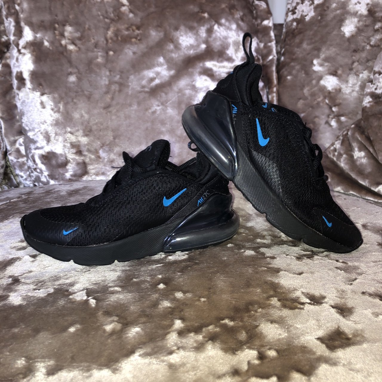 Kids black Nike trainers with blue tick