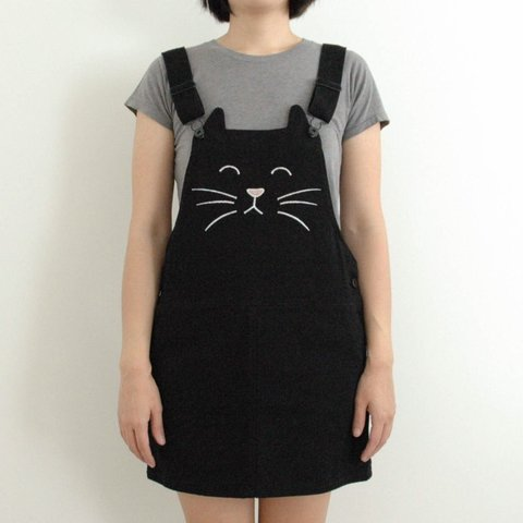 61f53afa18 Forever 21 black overall dress with cat face embroidered on - Depop