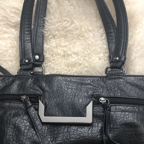 a89b5d3e3d90 @jclay7. 3 months ago. Airmont, United States. Black tote bag. One large interior  zip pocket