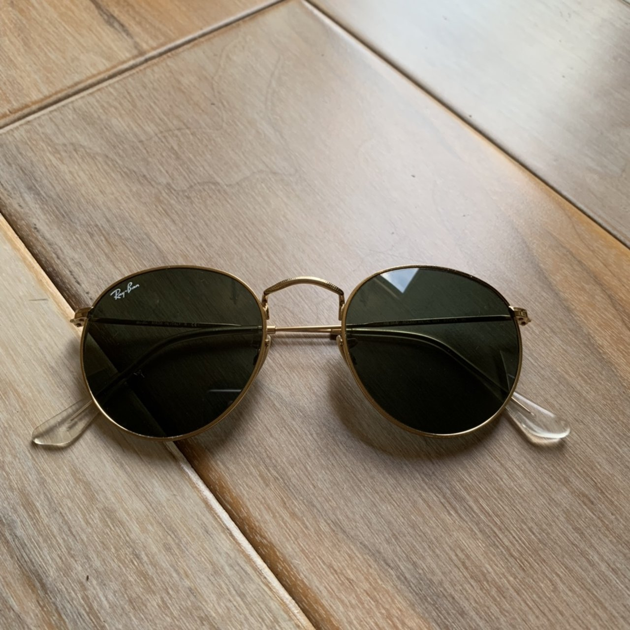 bbcde6c649 Gold round metal Ray Ban sunglasses. Tiny scratches on the a - Depop