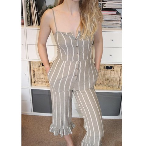 70cedd5295fe Beautiful grey   white striped jumpsuit with frill detail on - Depop