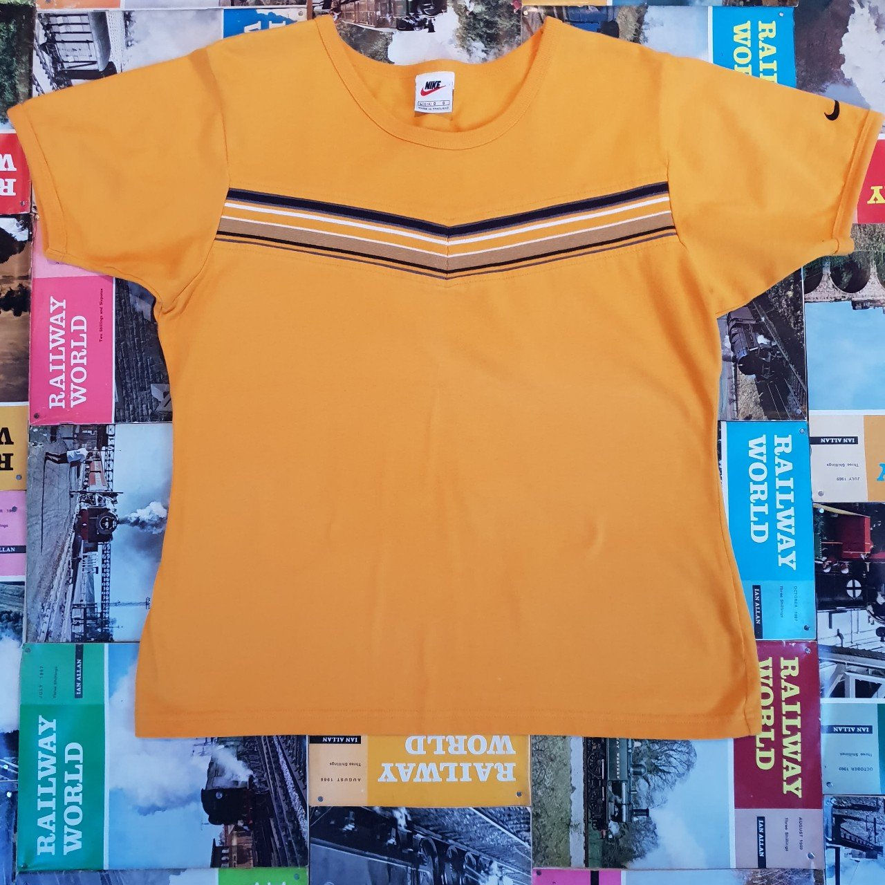Yellow Vintage womens Nike t-shirt. Medium Any questions on - Depop 1447497714