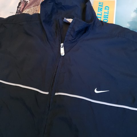 72faa7f6d Mens Nike Track Jacket Size Large Navy blue, with classic on - Depop