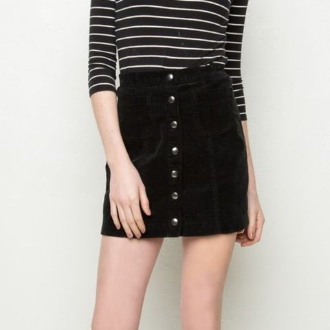 ef66441463 @lilbebzz. 2 years ago. Fontana, United States. brandy melville black  corduroy skirt with silver buttons ...